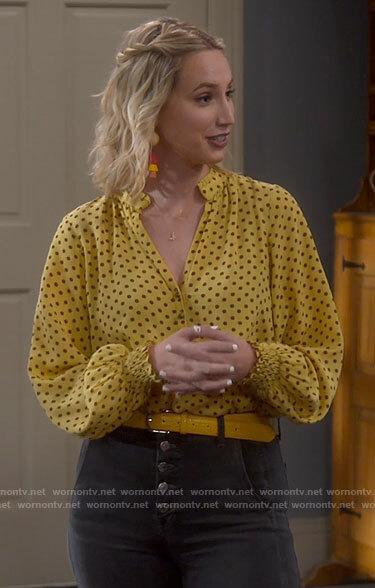 Mandy's yellow polka dot blouse on Last Man Standing