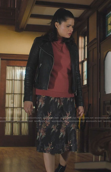 Mel's pink sweater, leather jacket and floral skirt on Charmed