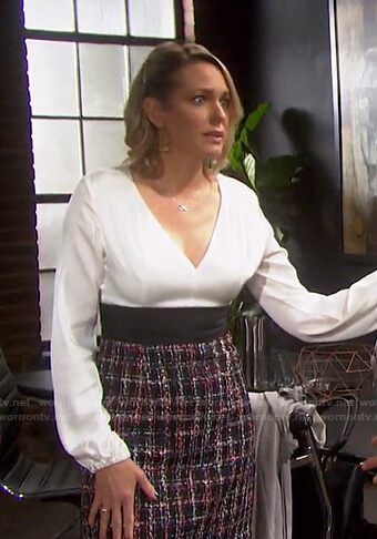 Nicole's white v-neck top and tweed skirt on Days of our Lives