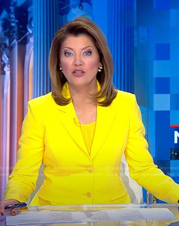 Norah's yellow blazer on CBS Evening News