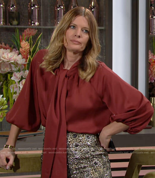 Phyllis's red bow neck blouse on The Young and the Restless