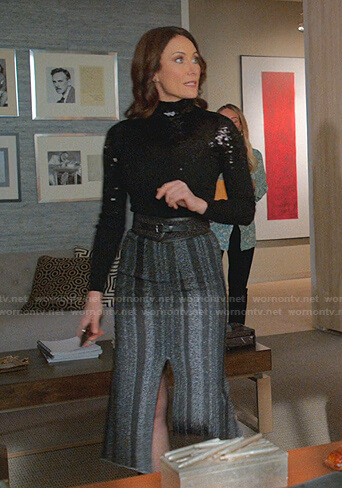 Quinn's black sequin turtleneck sweater and striped skirt on Younger