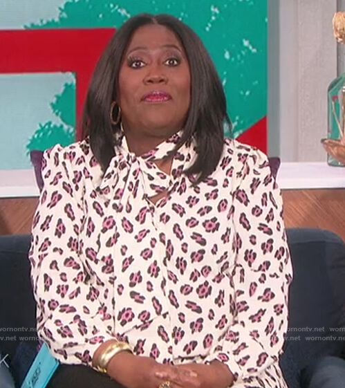 Sheryl's white leopard print blouse on The Talk