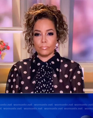 Sunny's black polka dot tie neck blouse on The View
