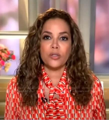 Sunny Hostin's red geometric tie neck blouse on Good Morning America