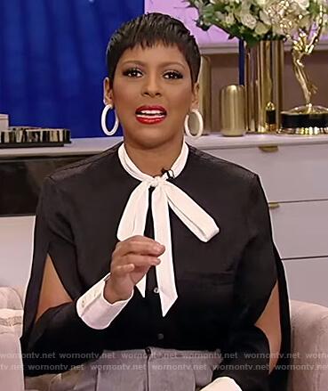 Tamron's black tie neck blouse with split sleeves on Tamron Hall Show