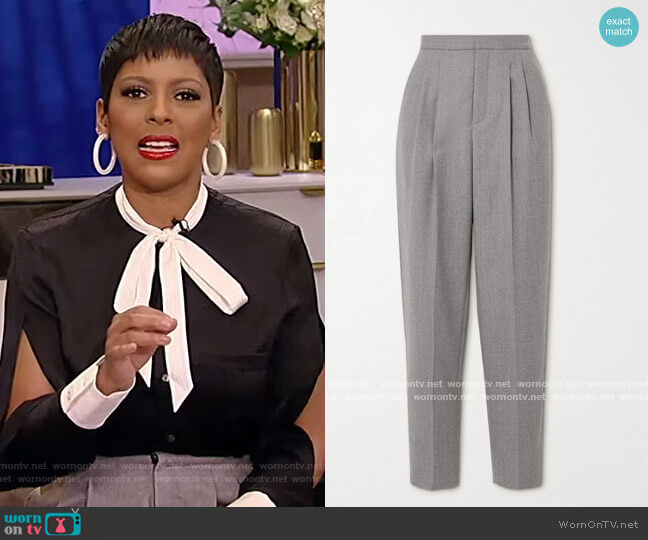 Pleated wool-twill tapered pants by Saint Laurent worn by Tamron Hall  on Tamron Hall Show