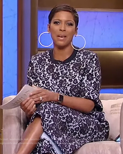 Tamron's blue floral lace top and pants on Tamron Hall Show