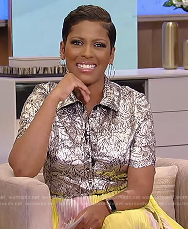 Tamron's metallic floral blouse and floral pleated skirt on Tamron Hall Show