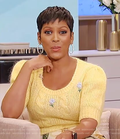 Tamron's yellow floral embroidered sweater on Tamron Hall Show