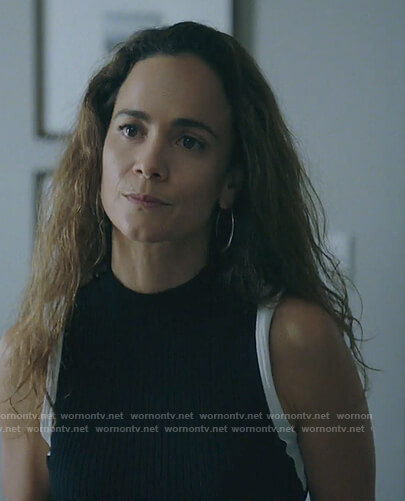 Teresa's black sleeveless top with contrast trim on Queen of the South