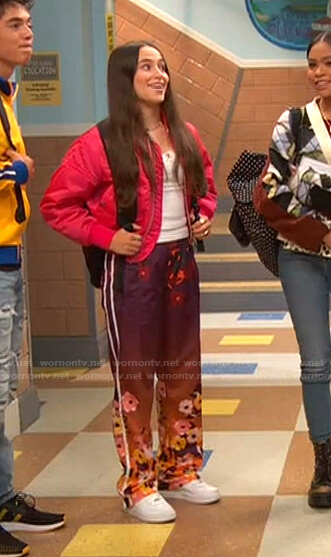 Tess's pink bomber jacket and floral pants on Ravens Home