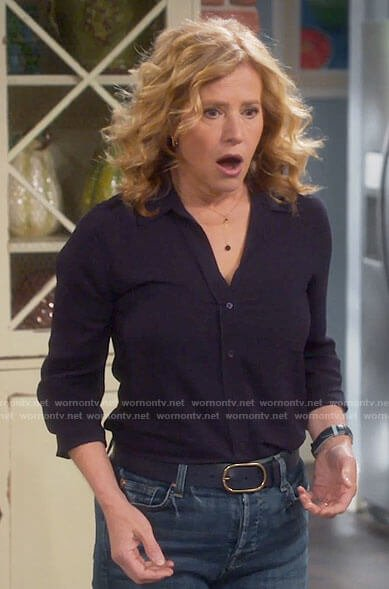 Vanessa's navy button down top on Last Man Standing