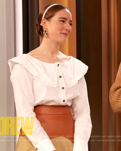 Young Emperor's white ruffle blouse and skirt on The Drew Barrymore Show