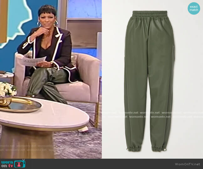 Leather track pants by Alexander McQueen worn by Tamron Hall  on Tamron Hall Show