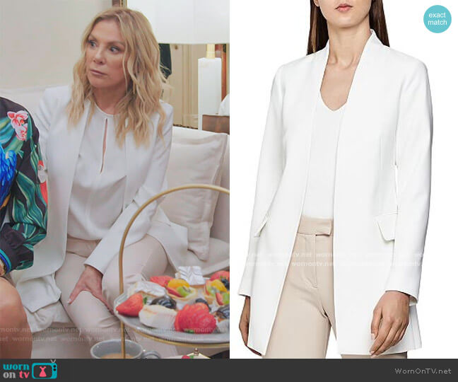 Tally Collarless Open Jacket and beige pants by Reiss worn by Ramona Singer  on The Real Housewives of New York City
