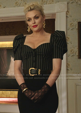 Alexis's black striped puff sleeve top on Dynasty