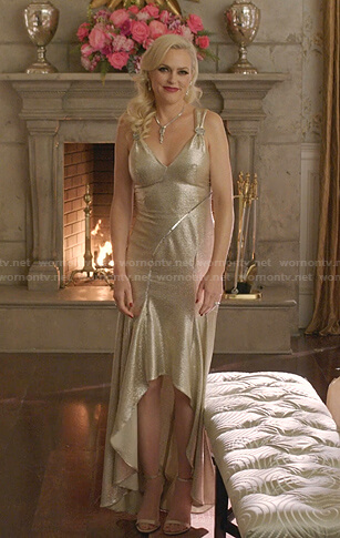 Alexis's gold metallic high-low dress on Dynasty