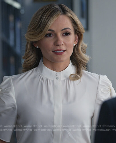 Amy's white puff sleeve blouse on All Rise
