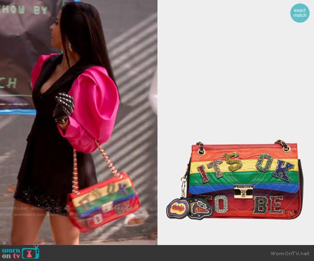 Betsey Johnson Its Ok To Be Bag worn by Wickie Roy (Renée Elise Goldsberry) on Girls5eva