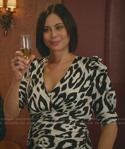 Cassie's black and white printed surplice top on Good Witch