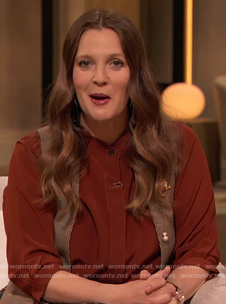 Drew's burgundy blouse and printed skirt on The Drew Barrymore Show