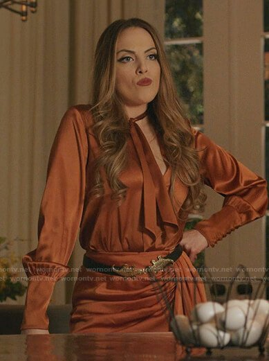 Fallon's orange tie neck top and skirt on Dynasty