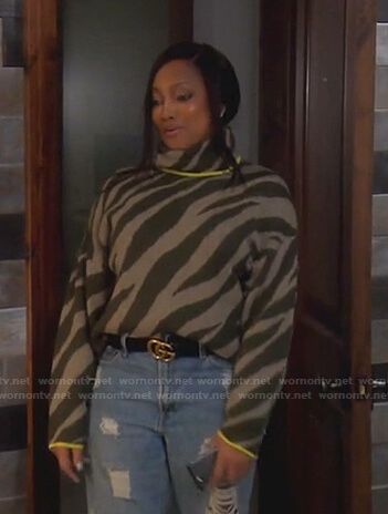Garcelle's green zebra print sweater on The Real Housewives of Beverly Hills