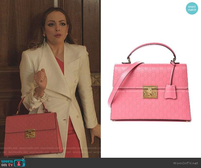 Signature Medium Padlock Top Handle Bag by Gucci worn by Fallon Carrington (Elizabeth Gillies) on Dynasty