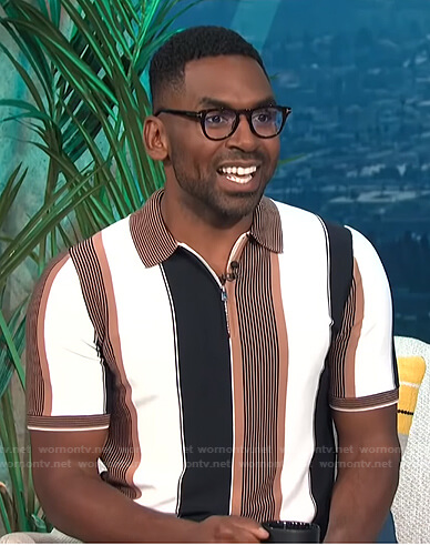 Justin's brown, black and white striped polo shirt on E! News Daily Pop