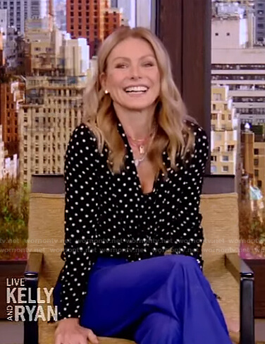 Kelly's black polka dot blouse and blue pants on Live with Kelly and Ryan