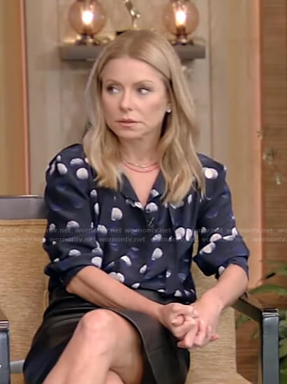 Kelly's navy dotted tie neck blouse on Live with Kelly and Ryan