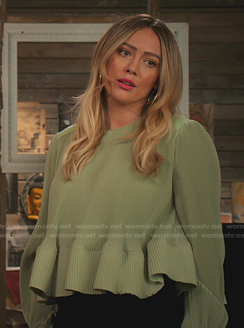 Kelsey's green pleated peplum top on Younger