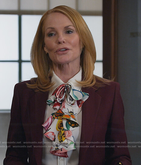 Lisa's white contrasting stitch blouse on All Rise