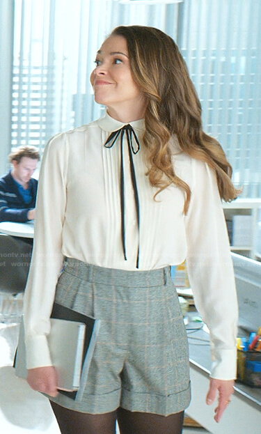 Liza's white tie neck blouse and gray checked shorts on Younger