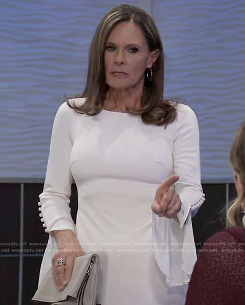 Lucy's white bell sleeve sheath dress
