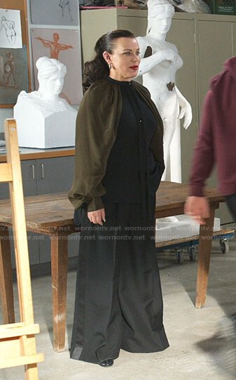 Maggie's black and green cape-sleeve blouse and wide leg pants on Younger