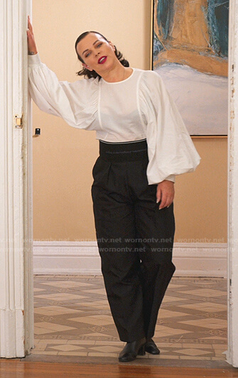 Maggie's white flared sleeve top and black high waist pants on Younger