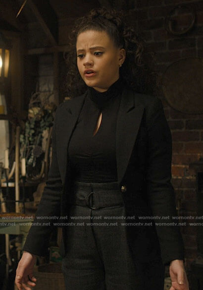 Maggie's black keyhole top, belted pants and black blazer on Charmed