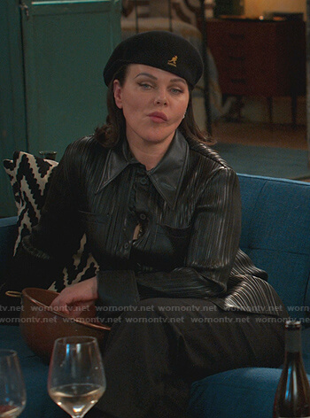 Maggie's black leather shirt and black cap on Younger