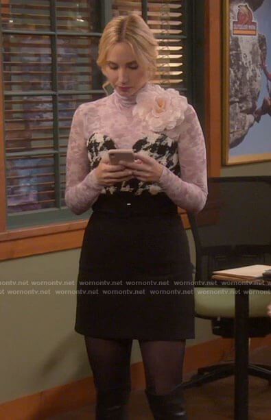 Mandy's houndstooth bustier and pink floral turtleneck on Last Man Standing