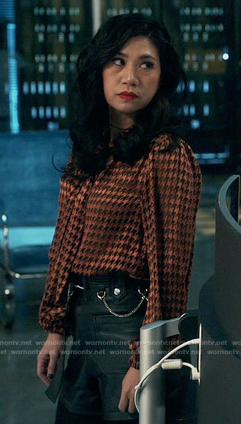 Mel's houndstooth blouse and leather shorts on The Equalizer