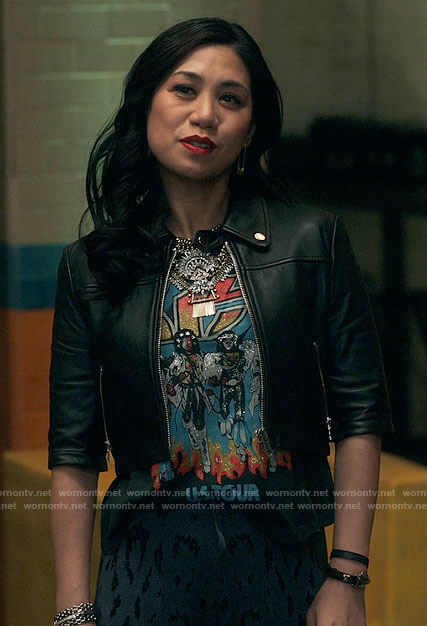 Mel's KISS shirt and cropped leather jacket on The Equalizer