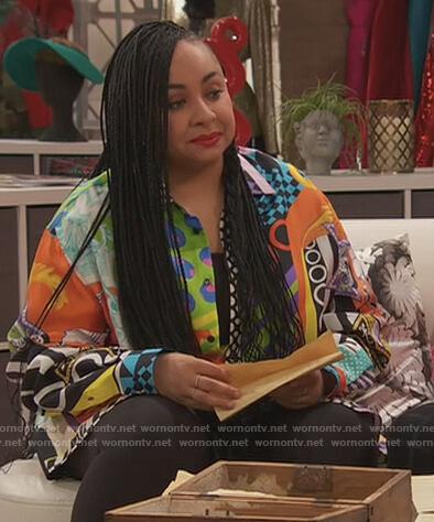 Nia's blue heart print sweater on Ravens Home