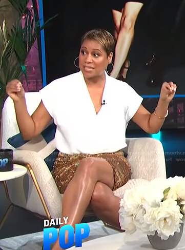 Monique Kelley's white top and gold sequin skirt on E! News Daily Pop