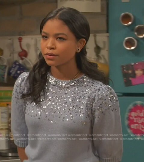 Nia's blue sequin embellished sweater on Ravens Home