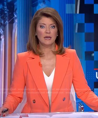 Norah's orange double breasted blazer on CBS Evening News