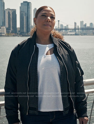 Robyn's white cutout tee, houndstooth jacket and bomber jacket on The Equalizer