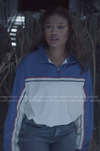 Ryan's blue and white half zip top on Batwoman