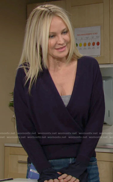 Sharon's navy wrap front sweater on The Young and the Restless